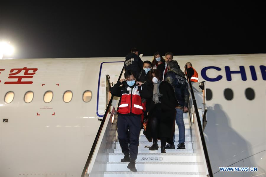 Members of a Chinese aid team arrive at Fiumicino Airport in Rome, Italy, on March 12, 2020. [Photo/Xinhua]